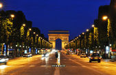 The Champs-Elysees at night, Paris — 图库照片