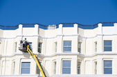 Cleaning sash windows — Stockfoto