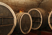 The old wine cask in the cellar — Stock Photo