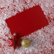 Christmas red background with white snowflake border — Stock Photo