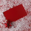 Christmas red background with white snowflake border — Stock Photo #7728471