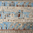 Egyptian hieroglyphic paintings on a temple wall — Stock Photo