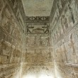 Egyptian hieroglyphic paintings on a temple wall - Stock Photo