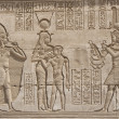 Hieroglypic carvings on an egyptian temple - Stock Photo