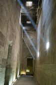 Corridor inside an ancient egyptian temple with light beams — Stock Photo