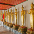 Many of the golden Buddha statue stand - 图库照片