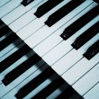 Piano keyboard in blue - Stok fotoğraf