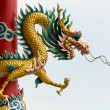 Golden Chinese Dragon Wrapped around red pole - Stok fotoğraf