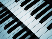 Piano keyboard in blue — Stock Photo