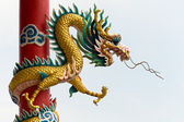 Golden Chinese Dragon Wrapped around red pole — Foto Stock