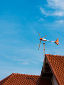 Aircraft that the wind direction on red roof — Stock Photo