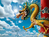 Golden Chinese Dragon and bright sky — Stock Photo