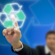 Front of Businessman index press on recycle logo — Stockfoto