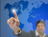 Front of Businessman index press on world map — Stock Photo