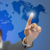 Left hand Businessman index press on world map — Stock Photo