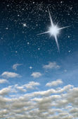 Bright star in blue sky — Stockfoto