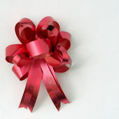 Red ribbon on white background — Stock Photo