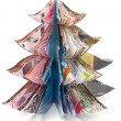 Stock Photo: Handmade Christmas tree cut out from fasion magazine
