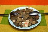 Um prato de dinheiro — Fotografia Stock