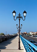 Lampposts on the jetty — Stock Photo