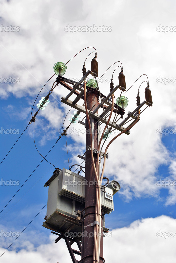 High voltage electricity pylon for the transport and transformation from high to low voltage — Stock Photo #7350798