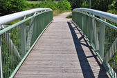 White wooden bridge in park — Stock Photo