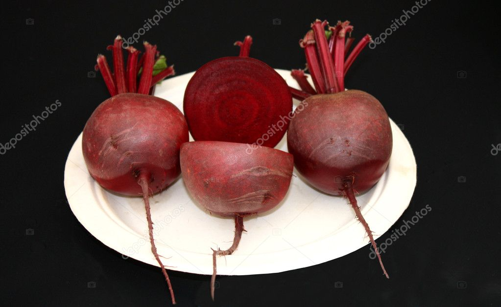 A Display of Three Freshly Grown Beetroots.  Stock Photo #7256994