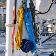 Zdjęcie stockowe: Colorful ropes hanging on yacht mast