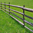 Fence on green meadow — Stock Photo #7114411