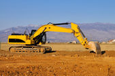 Excavator in the action — Stock Photo