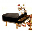 Piano figurine - Stock Photo