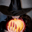 Witch with pumpkin in hands — Stock Photo