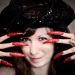Witch with black turban and long nails — Stock Photo