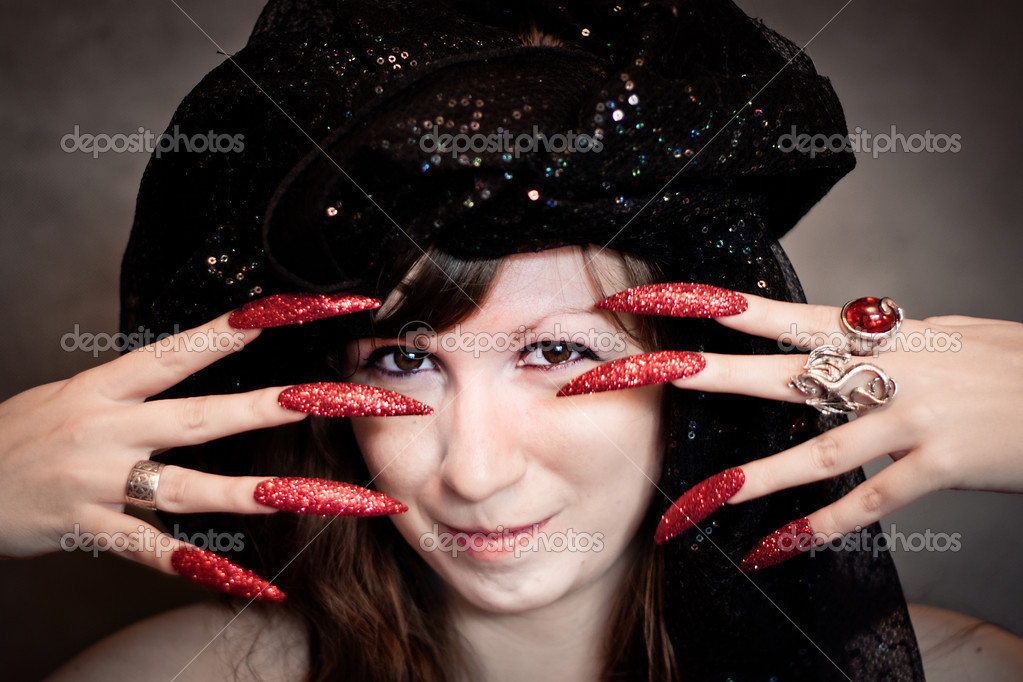 Pretty young witch with black turban and long nails — Stock Photo #6825990