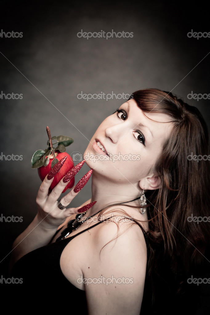 Pretty young lady with red apple and long nails — Stock Photo #6825991