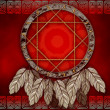 Dreamcatcher on red background — Stock Photo