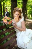Groom and bride with lollypop — Stock Photo