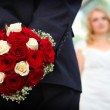Stock Photo: Groom holding wedding bouquet