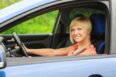 Smiling young woman in the car — Stock Photo