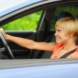 Smiling young woman in the car — Stock Photo #6852165