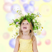 Girl with a wreath of flowers. — Stock Photo