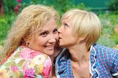 Girlfriends talking, gossips in secret — Stock Photo