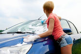 Woman washes her car — Stock Photo