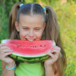 Stock Photo: Young girl eating watermelon