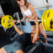 Man and a woman in the gym — Stock Photo #7432695