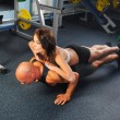 Man and a woman in the gym — Stock Photo #7432716