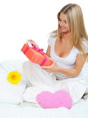 Young woman with a gift box — Foto de Stock