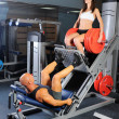 Man and a woman in the gym — Stock Photo #7524059