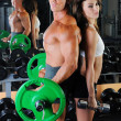 Man and a woman in the gym — Stock Photo #7524066