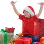 Cheerful boy in Santa Claus hat — Stock Photo #7536976